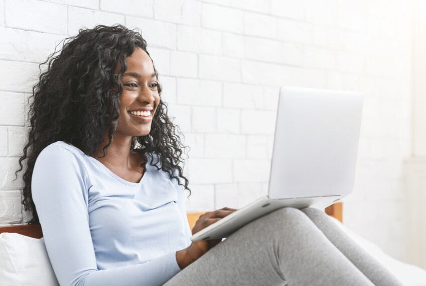 woman smiling at computer online dating