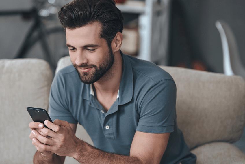 man using online dating app on phone