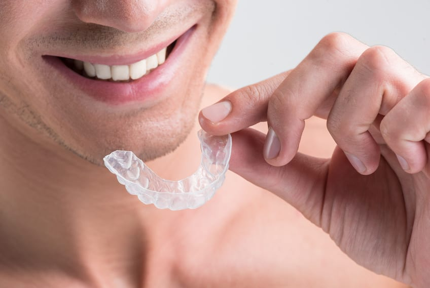 man holding invisible braces