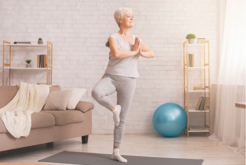 senior lady doing yoga exercise
