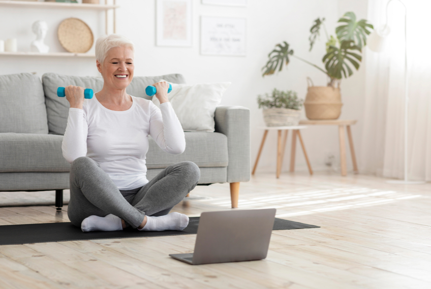 senior lady doing weights exercise